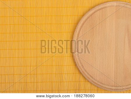 Empty Round Wooden Board With Tablecloth.