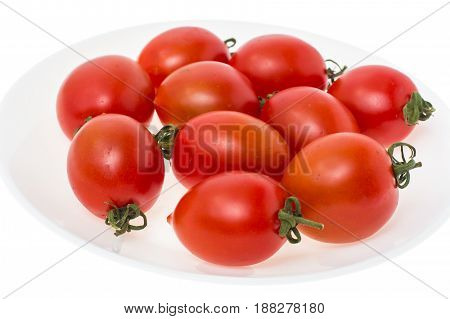 Healthy food: cherry tomatoes on white plate isolated. Studio Photo
