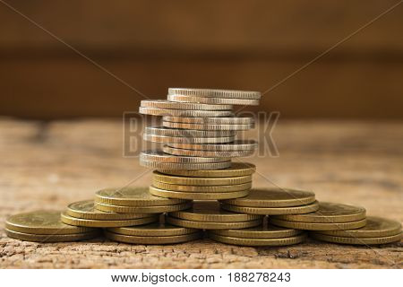 money concept saving and growthimage of gold and silver coins stack.