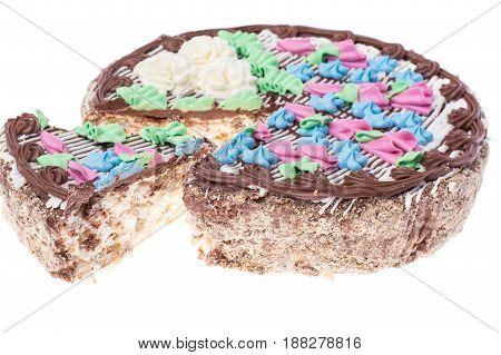 Cake with cream, nuts and meringue. Studio Photo