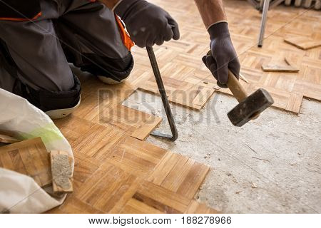 Worker Removes Old Fparquet, Renovation Home