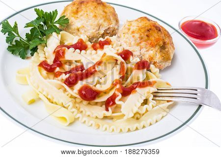 Meat cutlets with pasta and ketchup. Studio Photo
