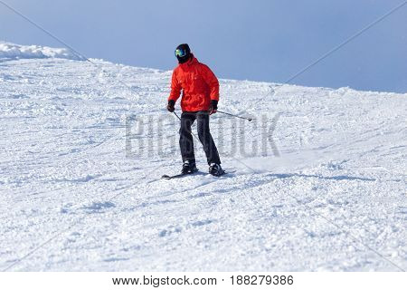 Athlete skiing in the snowy mountains . A photo