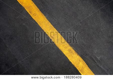 Single yellow line on road texture background