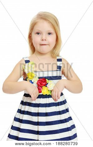 Cute little blonde girl in a striped summer dress.Isolated on white background.