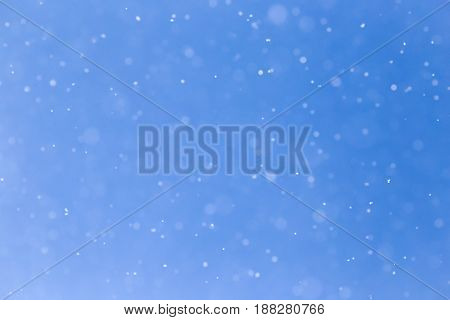 snowing on a blue sky. A photo