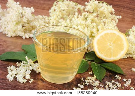 Fresh Healthy Juice, Elderberry Flowers And Lemon On Board, Concept Of Alternative Medicine