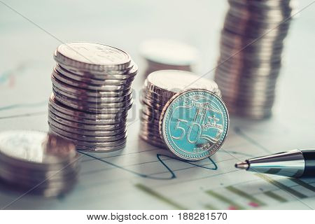Financial business concept with coins and business chart