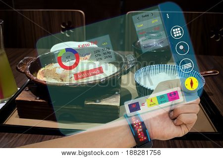 iotinternet of things smart watch conceptsman use augmented reality to calculate food intake and calories while have a foodthe data compare the meal with run bikingand weight training