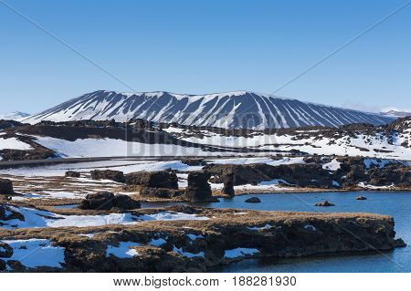 Myvatn volcano with clear blue sky background Iceland winter natural landscape background