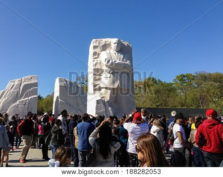 Washington DC - April 7 2012: Tourists around the Martin Luther King Junior Memorial in Washington DC
