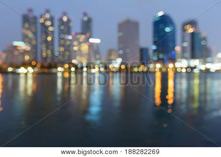 Twiight night blurred bokeh reflection light office building abstract background