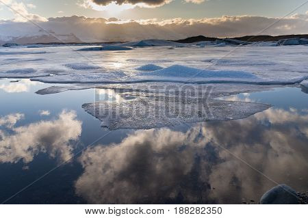 Frost winter lake with blue sky reflection Iceland natural landscape background
