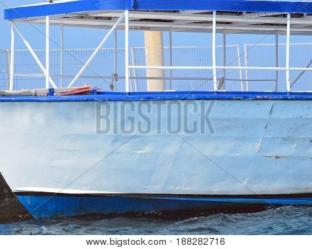 Tour boat docked for tourist to sightsee around the caribbean island.