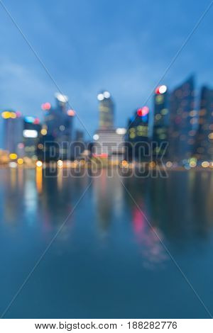 Night blurred bokeh light Singapore city with reflection abstract background