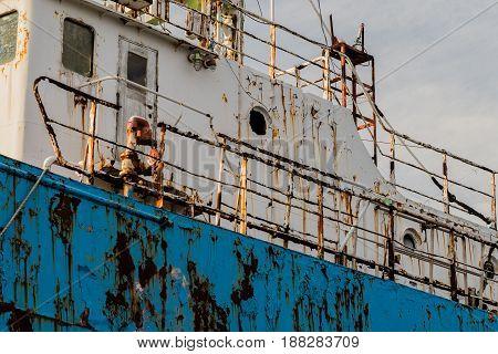 Closeup of side old rusty abandoned ship taken at a marine junkyard in South Korea