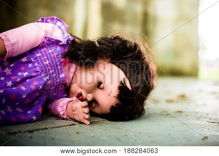 Andoned PersonAbandoned doll laying on Dirty floorvintage tone