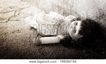 Andoned PersonAbandoned doll laying on Dirty floorback and white tone