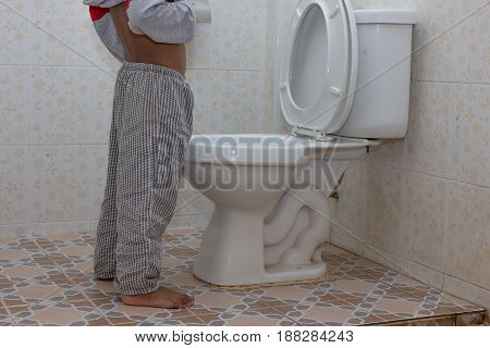 little asian boy urine in the toilet