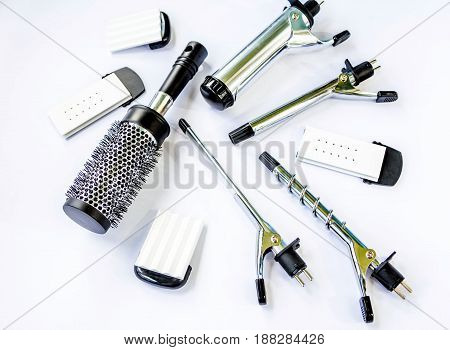 Hairstyling set. Hair curler iron accessories and  brush  on a white background