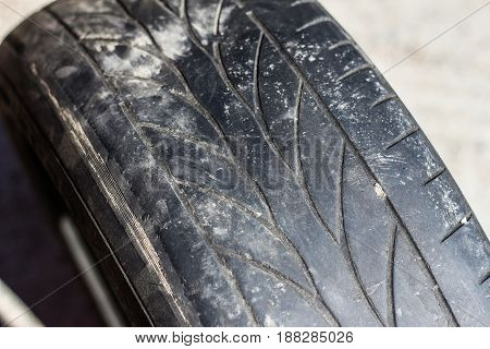 Old worn car tires on a gray background