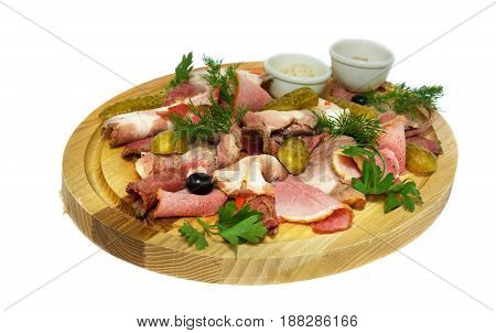 meat slices with cucumber and green, on the wooden substrate. on isolated background