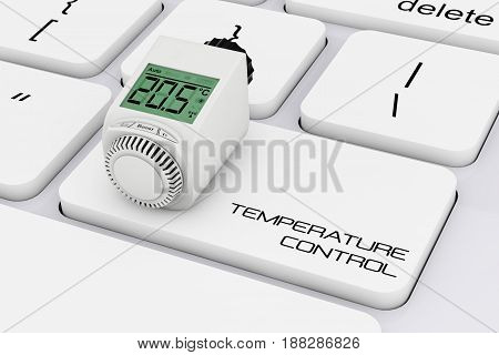 Digital Wireless Radiator Thermostatic Valve over Computer Keyboard with Temperature Control Sign extreme closeup. 3d Rendering.