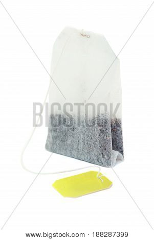 Teabag with yellow label isolated on a white background