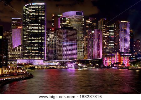 SYDNEY AUSTRALIA - MAY 26 2017; CBD buildings and Circular Quay coloured during Vivid Sydney annual festival of light music and ideas.