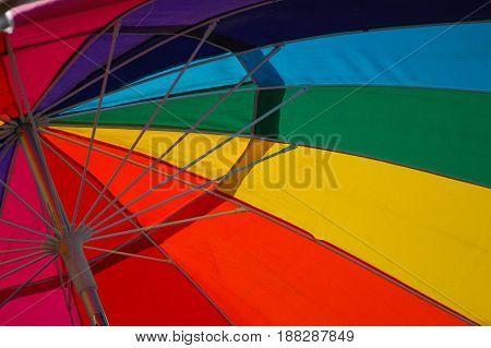 Rainbow of Color in a beach umbrella