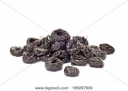 Heap of dried plums isolated on white background