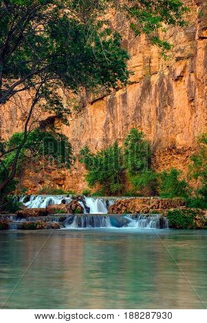 Beautiful afternoon light reflecting off of the red rock cliffs on Havasu Creek. This shot taken below Havasu Falls and just above Beaver Falls.
