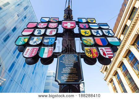 London England - 9 April 2017 - Cantonal Tree displays 26 Coats of Arms of Switzerland in London England on April 9 2017