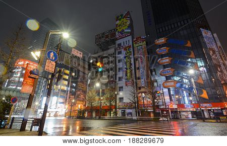 TOKYO, JAPAN - APRIL 8, 2017 - Rain glitters in the night lights of Akihabara, Tokyo's famous electronics shopping district popular with geeks and gamers