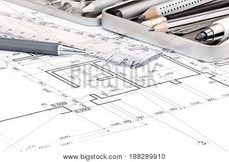 Pens, Ruler And Other Drawing Tools On Blueprints Backgrounds