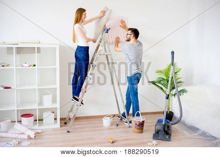 Young couple renovating their new house together