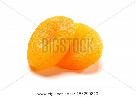 Two dried apricots isolated on white background