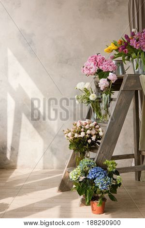 Display of flower shop with bouquets. Sale of ready-made compositions from multi-colored flowers. Mockup for advertising