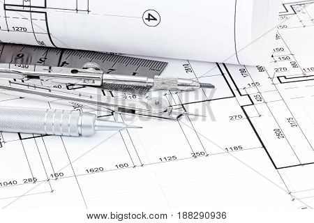 Drawing Compass, Ruler, Pen And Graphical Architectural Plans