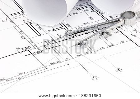 Architectural Blueprint Plans With Rolls And Drawing Compass