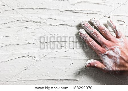 Worker Hand Stucco Plaster Wall Building Background Flat Lay Construction Repair Dirty White Concept