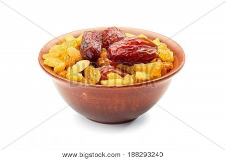Bowl of raisins and date fruits isolated on white background