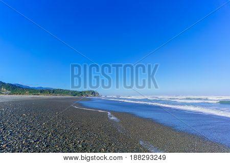 Beautiful Punakaiki beach in blue sky  , South Island of New Zealand