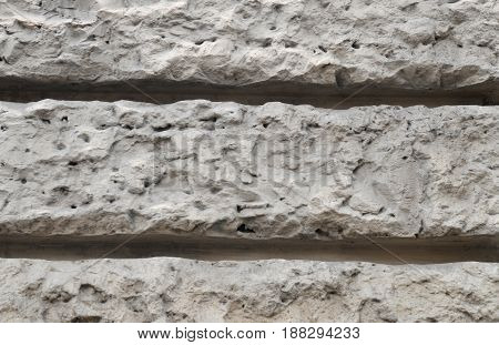 Grey brick wall texture photo close-up brick background macro view with bokeh