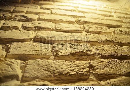 Yellow brick wall background texture close macro view pattern