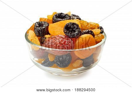 Glass bowl of dried fruits mix isolated on white background