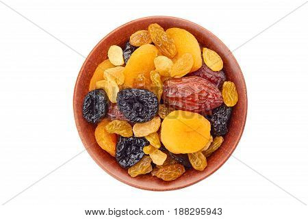 Bowl of dried fruits mix isolated on white background. Top view