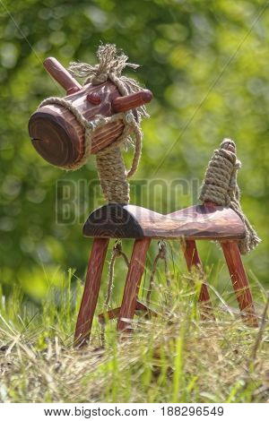 hand made wooden horse on green grass