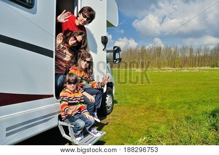 Family vacation, RV travel with kids, happy parents with children on holiday trip in motorhome, camper exterior