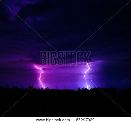 Two lightning bolts in a thunderstorm in the summer